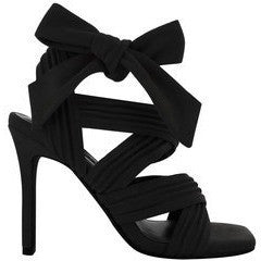 Stylish black pair of thick Strappy Stileto Heels made from Black Suede fabric, tied in a Gorgeouse knot for fastening on the side.