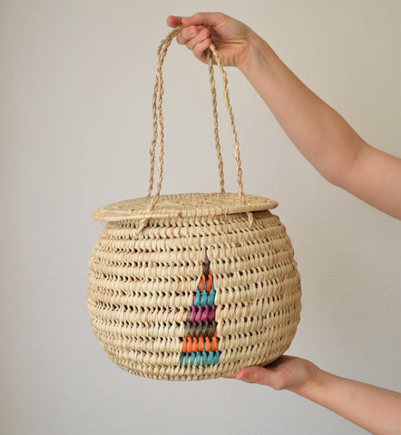 Woven round hanging basket with a lid