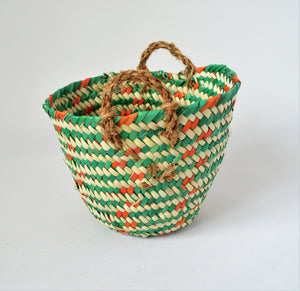 Colorful planter basket from palm straw