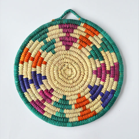 Woven trivet from palm leaves (People motifs)