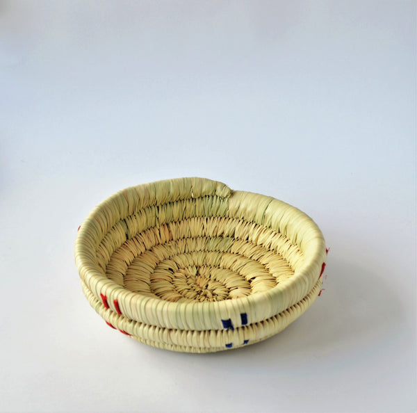 Natural wicker candy plate, decorated with colored fabric