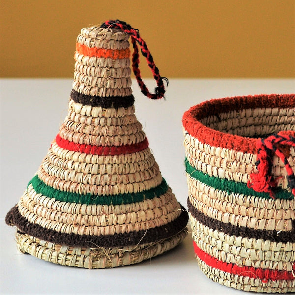 African basket enriched with colored wool yarn