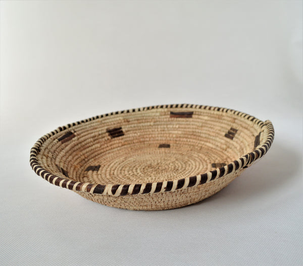 Woven straw and leather plate