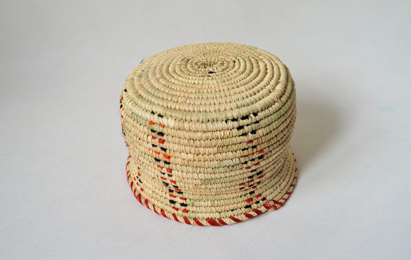 Wide woven bowl decorated with red and black fabric