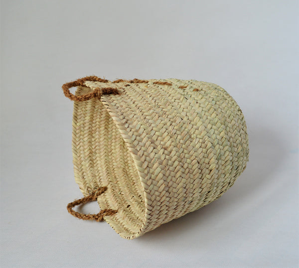 Natural palm straw basket with a strong natural handle from palm tree fibers