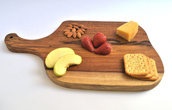 Rustic rosewood cutting board, organic shape, cut of one piece of wood