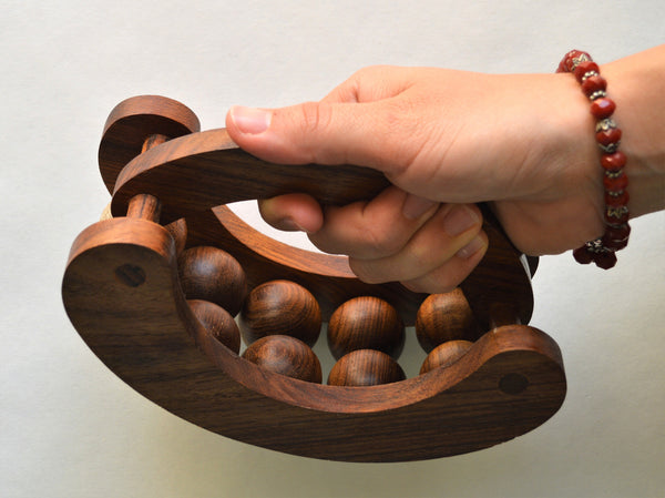 Wooden massage tool with 10 rolling balls