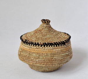 Round woven straw canister with a lid jewelry box