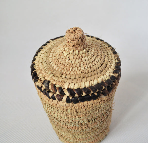 Long woven container lidded with true leather decoration