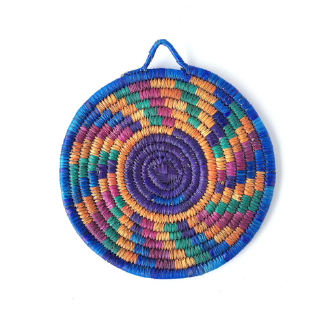 Blue Sun woven trivet from palm leaves