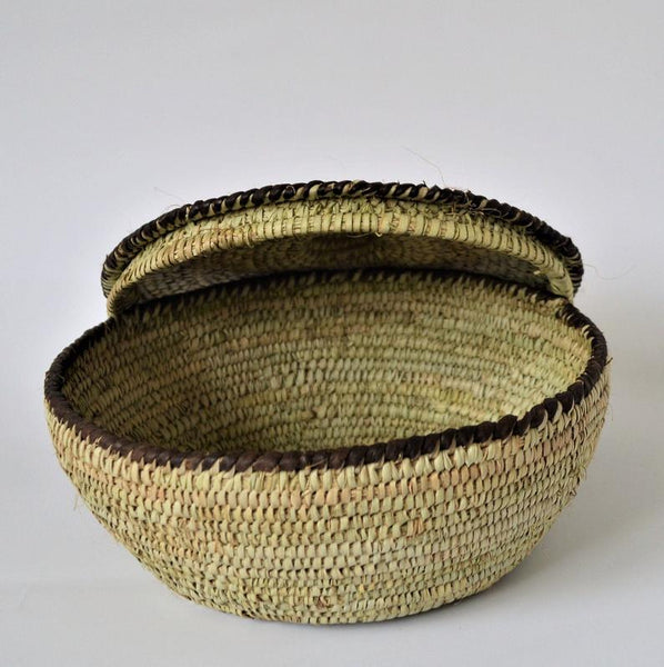 Round woven box decorated with leather