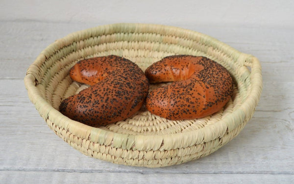 Round bread platter from palm leaves