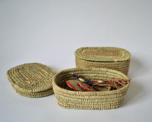 Small oval box for jewelry from palm leaves