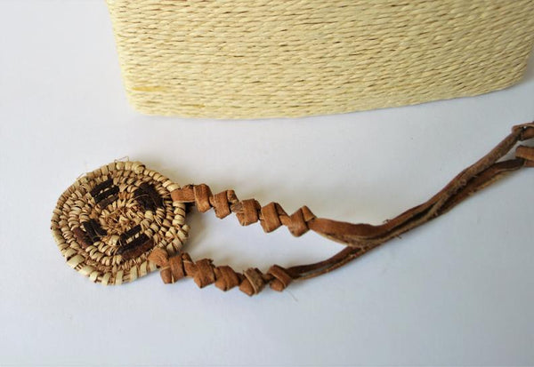 African necklace from natural leather and palm straw