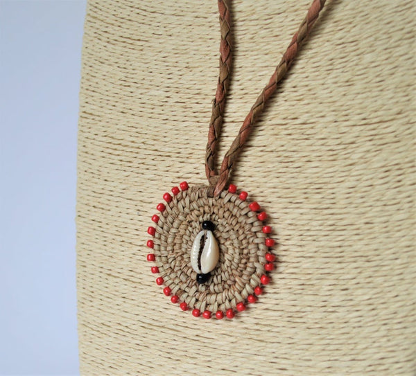 Woven African necklace with cowrie seashell