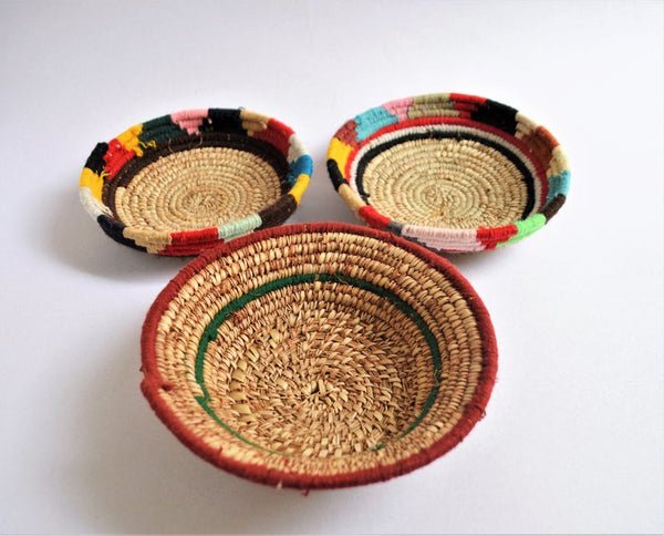 Tribal woven wall plates with wool decoration