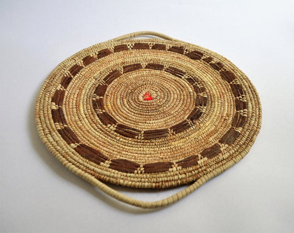 Tribal wall basket with goat leather decoration