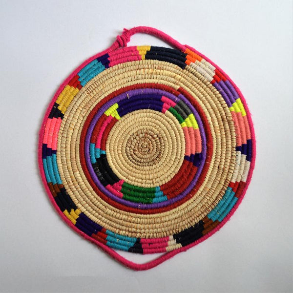 Tribal woven wall basket with wool decoration