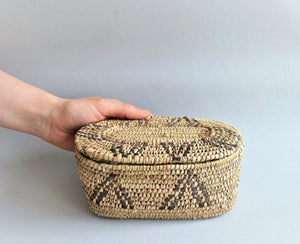 Oval box for jewelry from palm leaves and leather