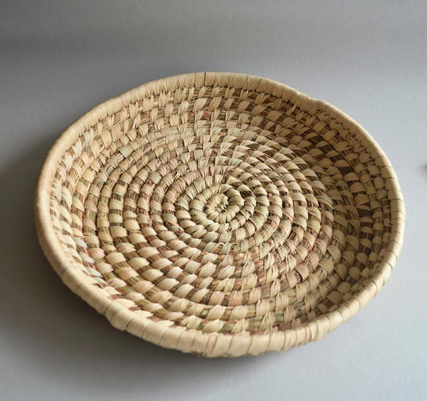 Round woven straw plate from Egypt