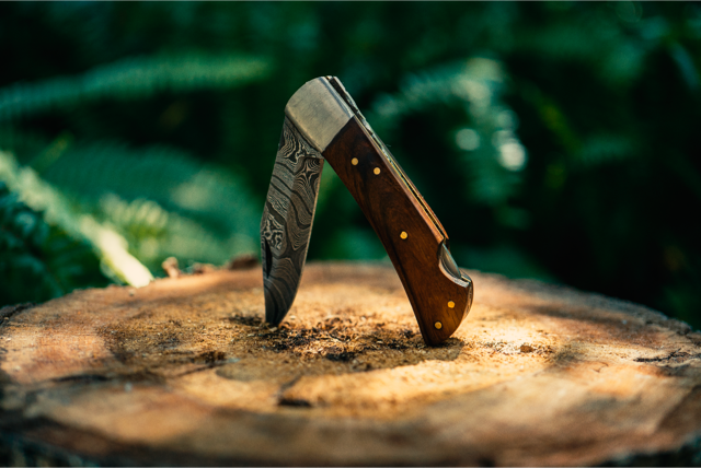 walnut damascus pocket knife