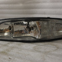 NOS NEW OEM 1997 BUICK LESABRE PASSENGER HEADLIGHT ASSEMBLY. 16524331