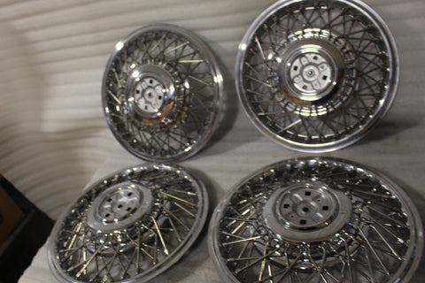 "NEW OEM 1986-1988 Cadillac Seville DEVILLE 14"" HUB CAPS (SET OF 4) 1633880"