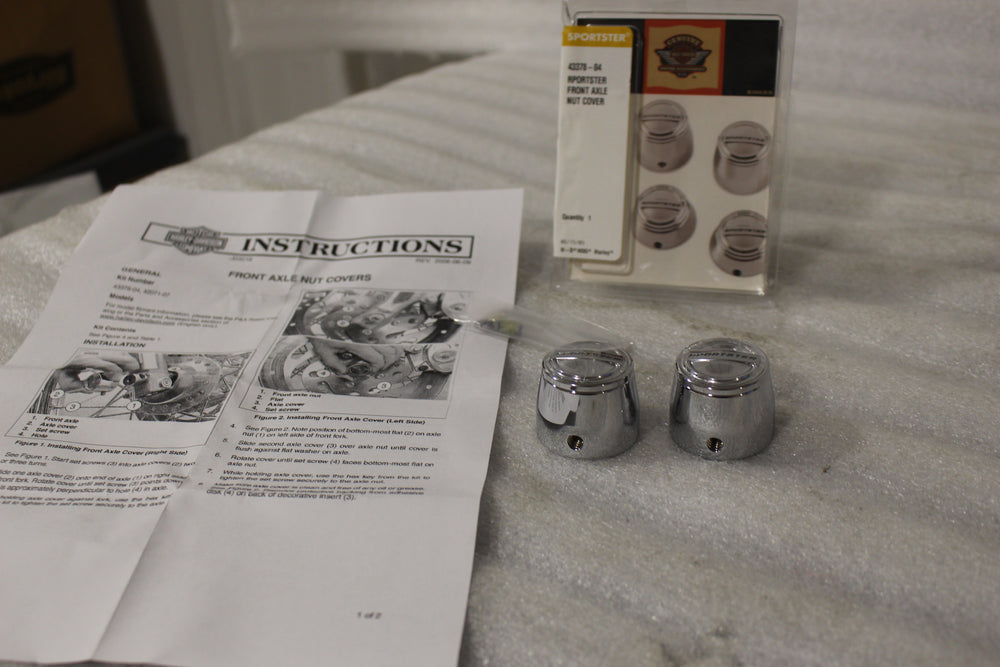NEW OEM NOS 1988-2007 HARLEY SPORTSTER FRONT AXLE NUT COVERS 43378-04