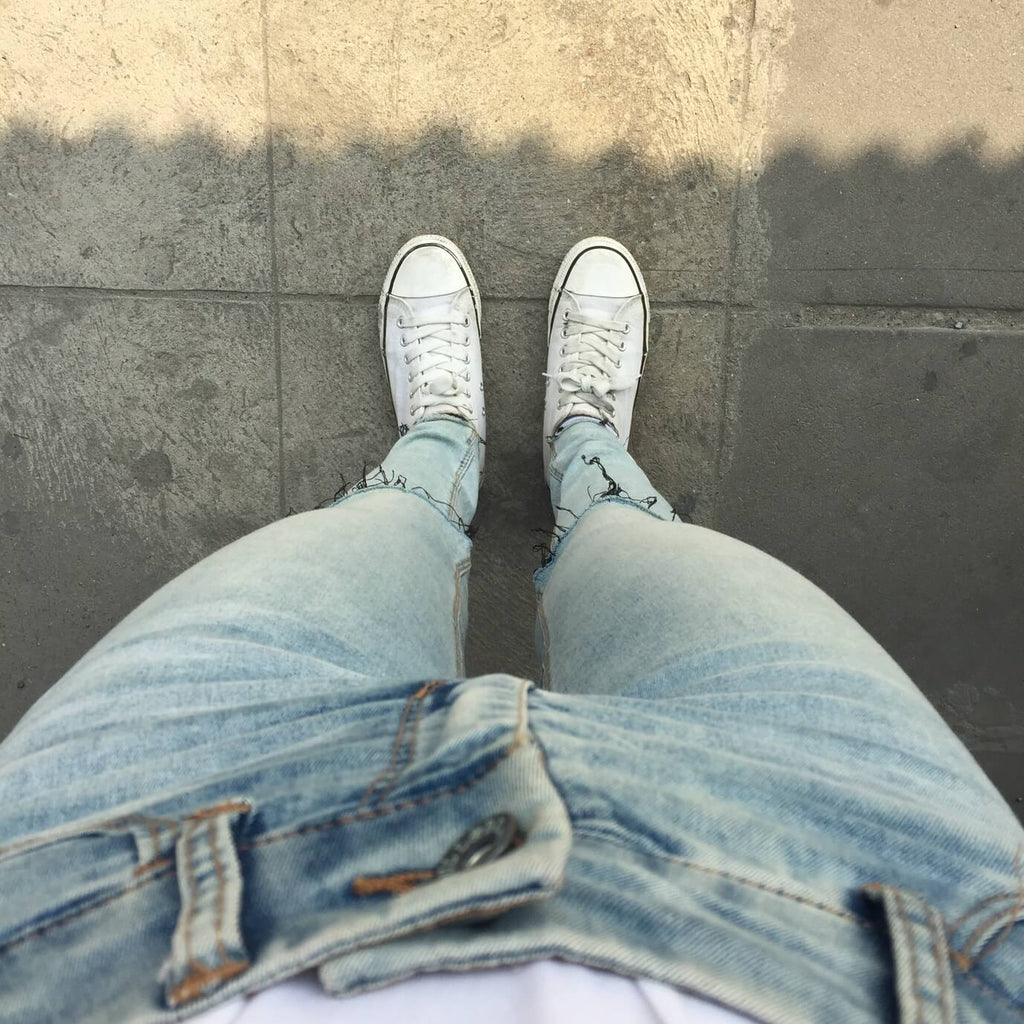 jeans and converse trainers with eyelets