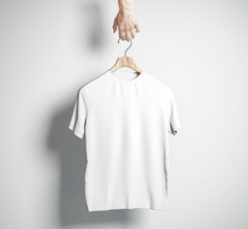 white cotton t-shirt on wooden coat hanger