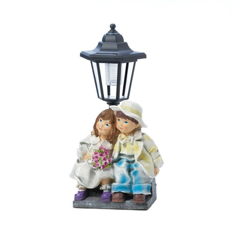COUPLE WITH SOLAR STREET LIGHT STATUE - Distinctive Merchandise