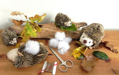 Hedgehog and hoglet sewing toy in a tin