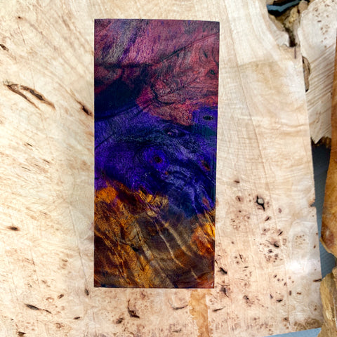 "Stabilized and triple dyed Buckeye Burl! Vacuum stabilized with Red, Purple and Orange Cactus Juice. Size: 2 5/8"" squared X 5 11/16"" long"