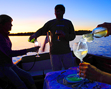 Serving wine at dusk with the help of a Hands-Free LED Grip-On Flashlight!