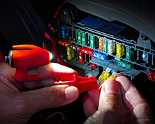Changing a car fuse in the dark is a cinch with a Grip-On Hands-Free LED Flashlight on your finger!