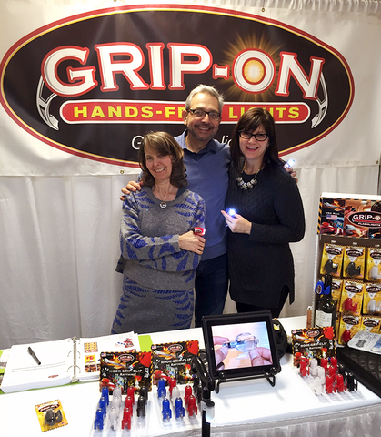 Tricia and Steve Labuzetta, Grip-On Attachable Flashlights owners, at The Atlanta International Gift & Home Furnishings Market, with Deb Fowler, owner of Milwaukee florist and gift shop, The Flower Lady.