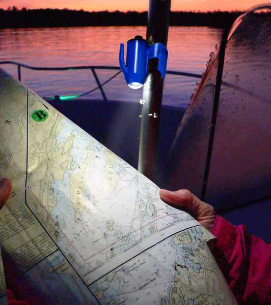 Reading a navigational chart at night on the boat—Grip-On Hands-Free LED Flashlights hold-on to virtually anything!