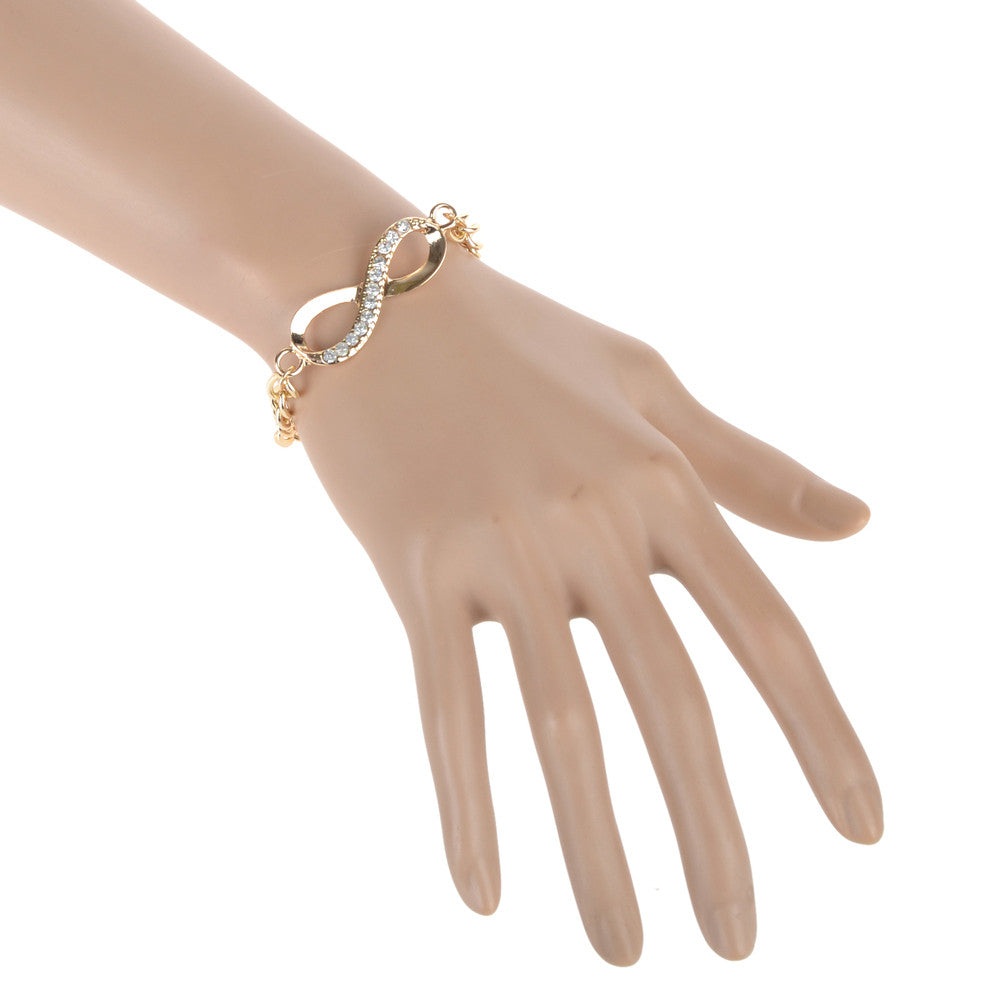 Ladies gold infinity symbol bracelet with crystals