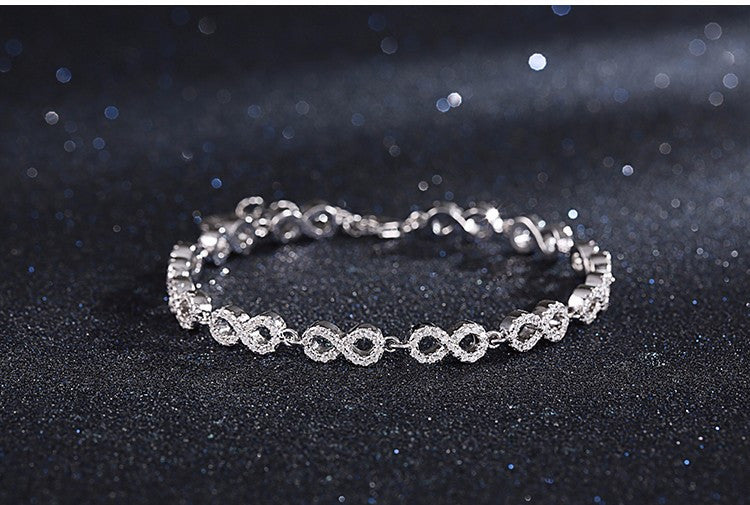 Ladies 925 Sterling Silver & Micro Pave Crystal Repeating Infinity Bracelet