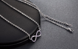 Silver Infinity Symbol Necklace with Purple Zircon Crystals
