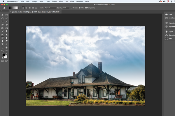 Use the gradient tool to apply a Photoshop sky overlay