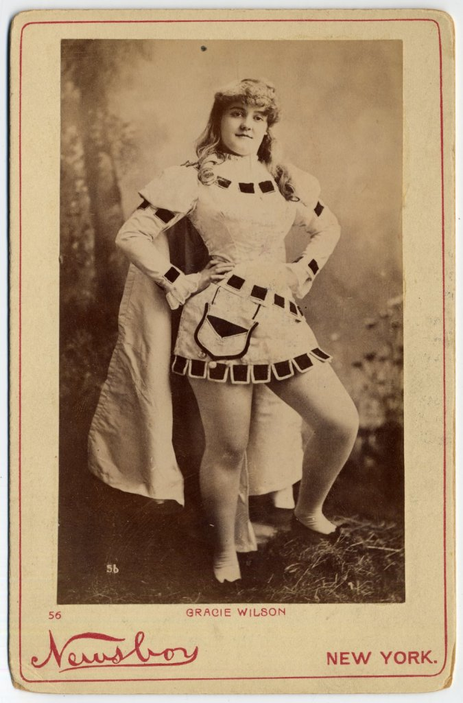 1890 Gracie Wilson. in costume with cape.