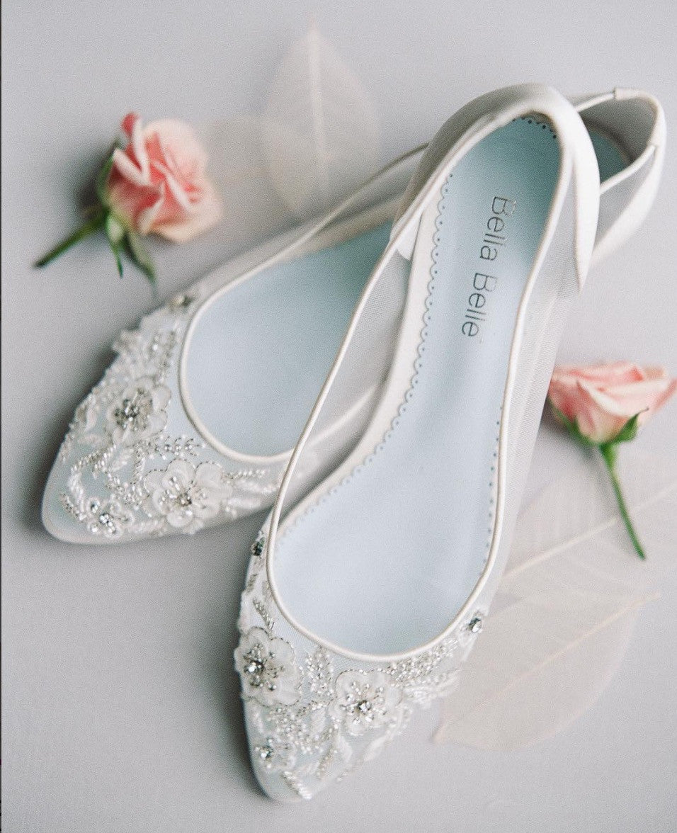 Wedding Flat Adora is white, comfortable, floral patterns, has crystal embroidery and a something blue sole.