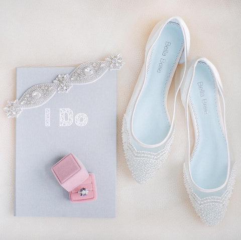 Wedding Flat Hailey is white, comfortable, has pearl patterns and a something blue sole.