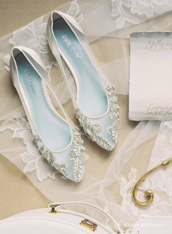 Wedding Flat Willow is white, comfortable, has a lace mesh sparkly with crystals and jewels and has a something blue sole.