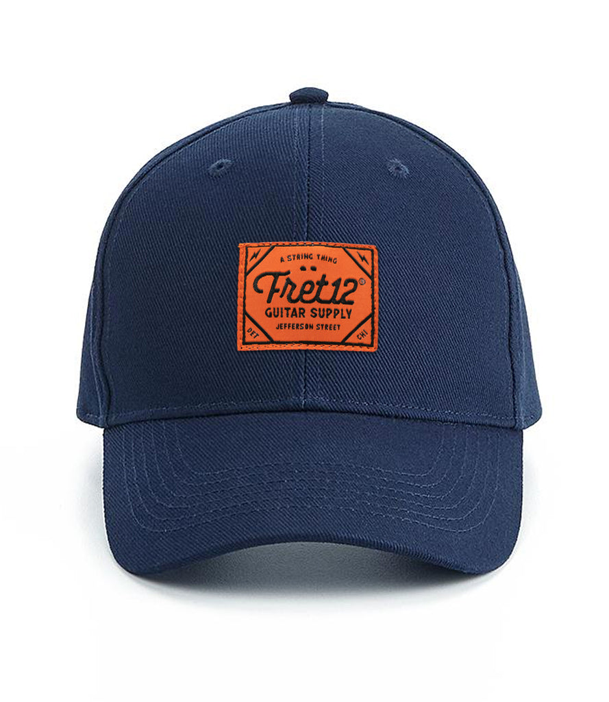 ORANGE BADGE 6 PANEL HAT – NAVY