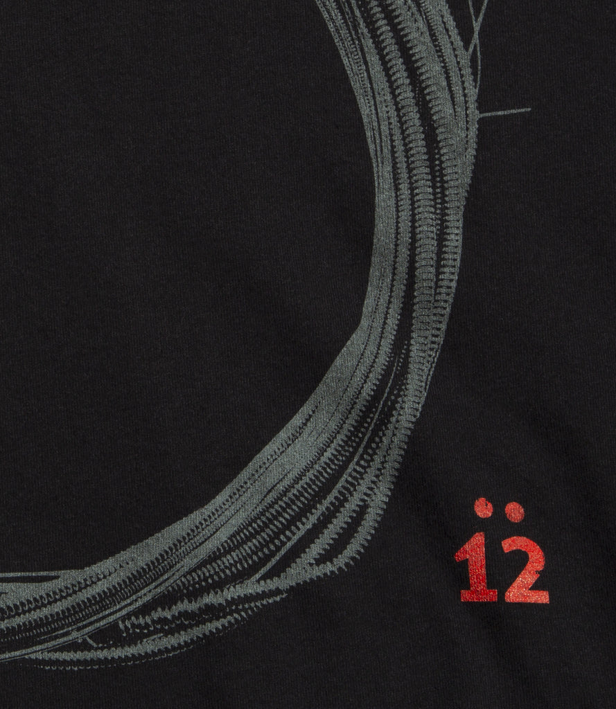 "The ""12"" Coil tee is part of the Core collection.  Logo view."