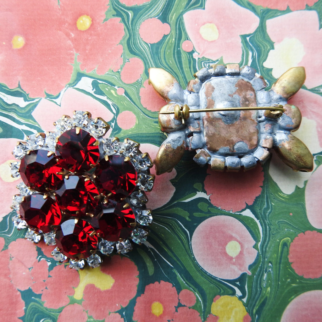 Red jeweled brooch