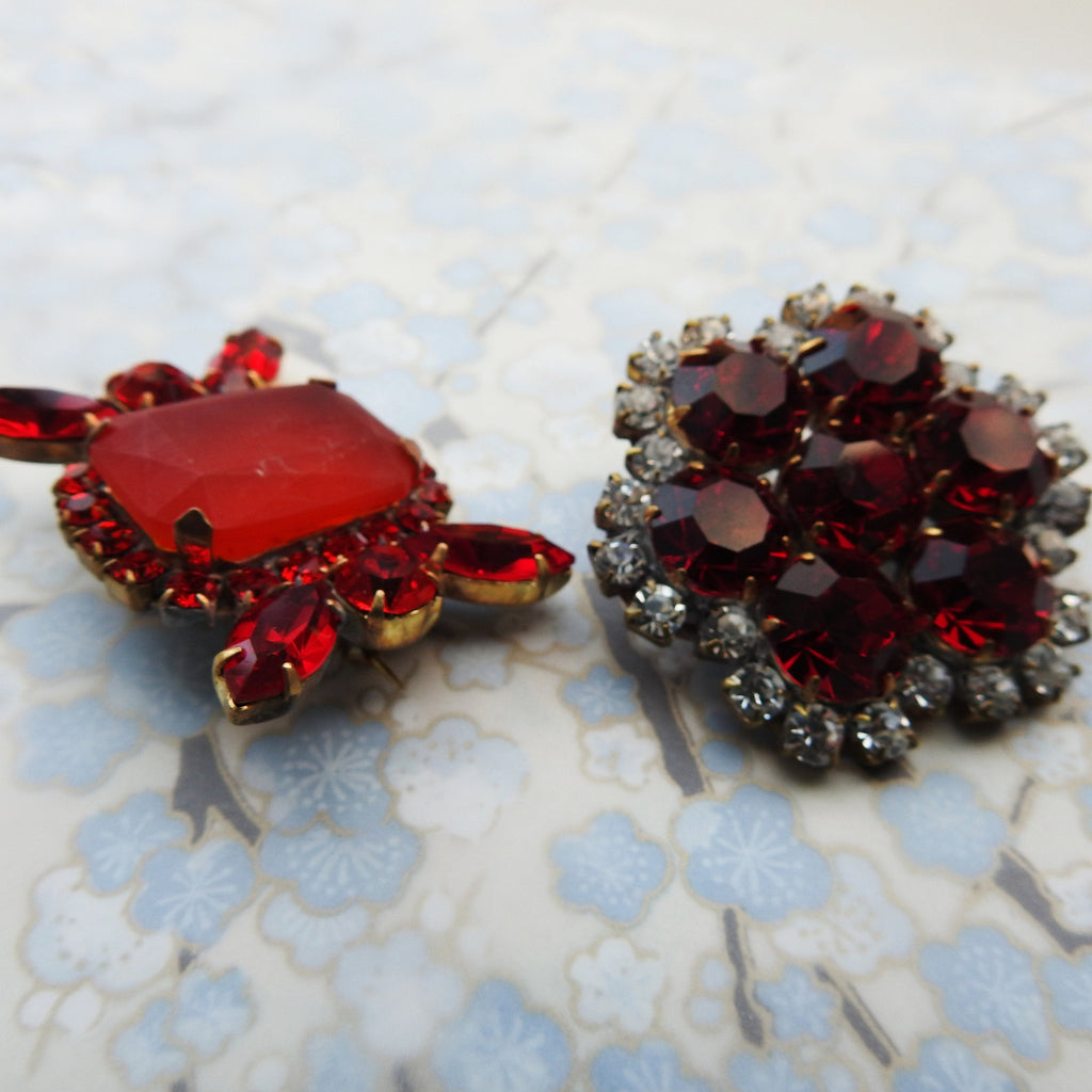 red brooches and pins