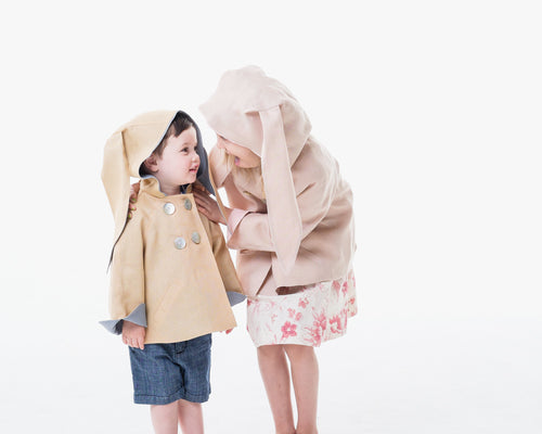 Boy and girl in linen bunny jackets